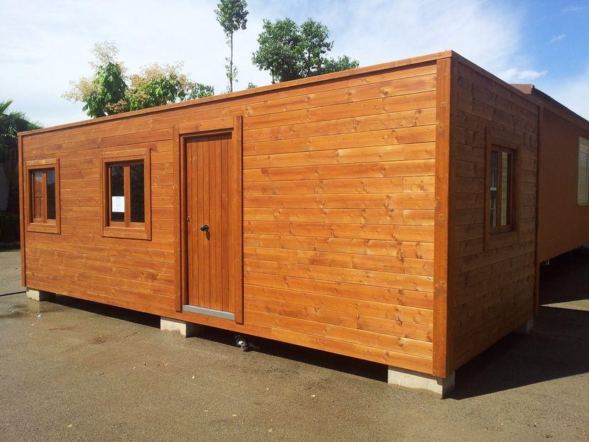 Oferta casa madera de exposici n casas carbonell - Refugios de madera prefabricados ...